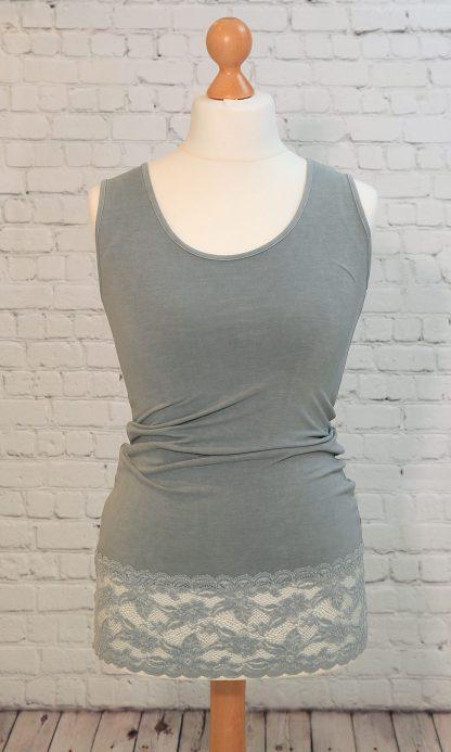 vest with deep lace hem