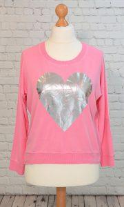 Pink heart sweatshirt top with split hem